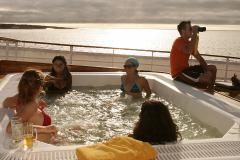 Fun time with friends on the jacuzzi of the Galapagos Yacht Evolution